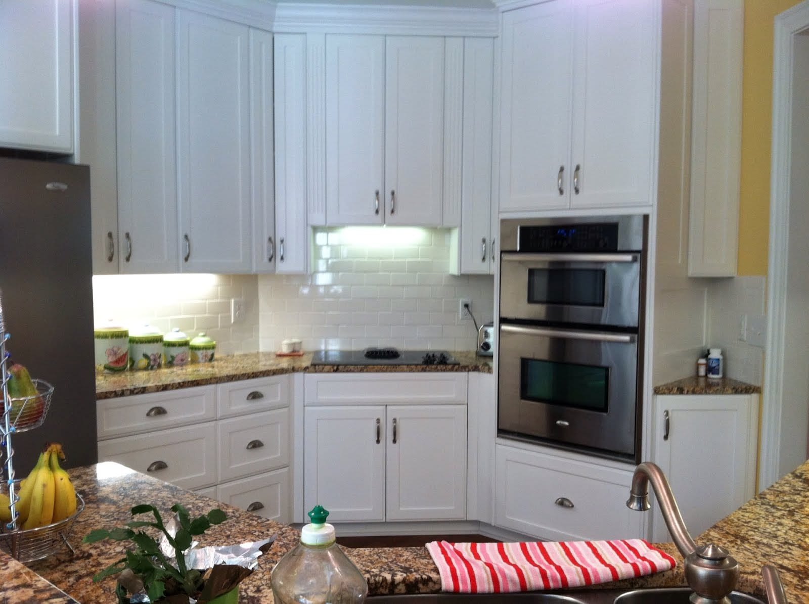 White Cabinets and Stainless Steel Kitchen