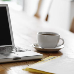 Laptop on Table with Cup of Coffee